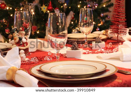 Atmospheric picture of a table set for christmas dinner