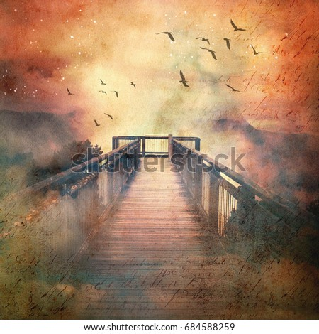 Atmospheric scene of a flock of birds and wooden walkway leading into low clouds in a surreal starry sky above misty mountains. Vintage, grunge textured image.