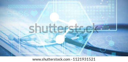 Atom against close-up of keyboard with stethoscope #1121931521