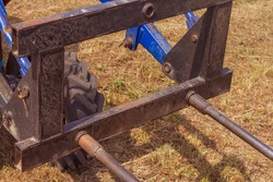 Attachments for a tractor, a fork for moving hay rolls. hay harvesting, seasonal work on the farm