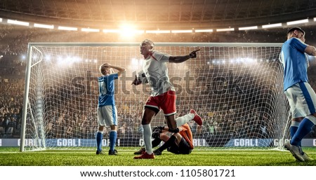 Attacker scores a goal, sending a ball past defenders and a goalkeeper on a professional soccer stadium. Stadium and crowd are made in 3D.