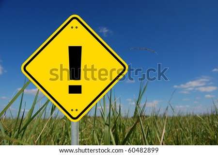 attention concept with exclamation mark in yellow traffic sign