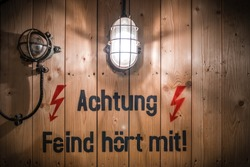 Attention Friend or Foe Achtung Feind hört mit sign in German ww2 Second World War communications bunker secret message dispatch with light and electric sign warning caution communicating in code