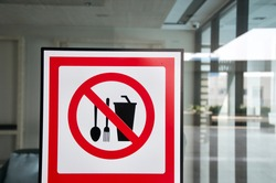 Attention Sign of food and drink not allowed bring from outside to restaurant. It is regulation from shopping mall. (Blurred background )