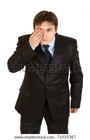 Attentive businessman closed his eyes with his hand  isolated on white