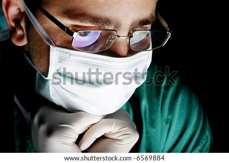 attentive look of working surgeon in operation room