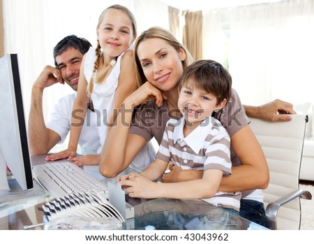 Attentive parents and their children using a computer at home