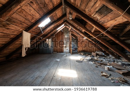 Attic room with clothesline, wooden trim and junk on the floor Photo stock ©