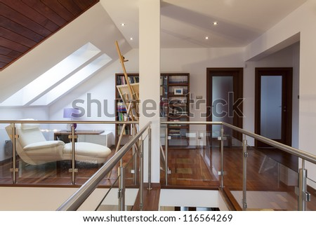 Attic with easel and painting in artist's house