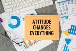 Attitude Changes Everything is written in a document on the office desk with office accessories.