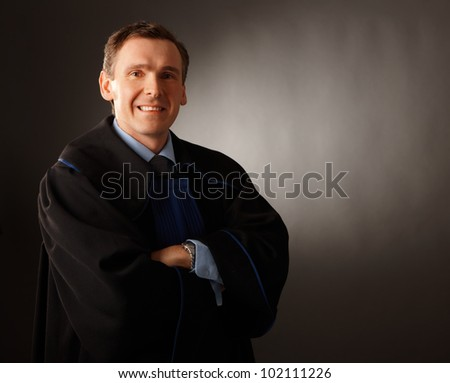 Attorney wearing classic gown standing