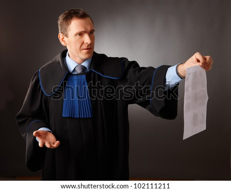 Attorney wearing classic gown talking in court - stock photo