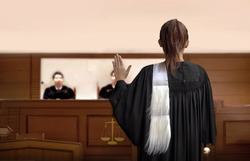 attorney woman on courtroom give swear words to magistrate in court room. Law and legal adjustment concept. The attorney communication on courthouse.