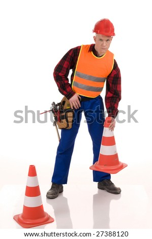 Attractiev road worker placing orange posts