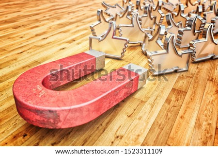Attracting many likes as a concept of a marketing strategy on social media networks, a red lead magnet attracts metal symbols of thumbs up on a wooden floor background, 3d illustration