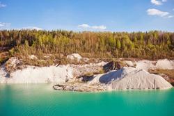 Attraction: Turquoise water chalk quarry landscape at Volkovysk Belarus.