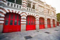 Attractive, accented brickwork facade and bright red painted garage doors of a fire station in singapore.