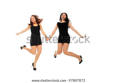 Attractive adult business women in formal wear jumping isolated on white background