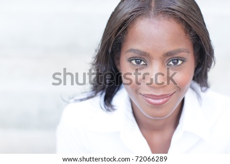 Attractive African American female posing outdoors