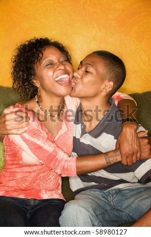 Attractive African-American woman with teen family member