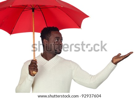 Attractive african man with a red umbrella isolated on a over white background