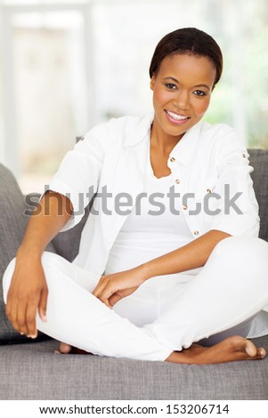 attractive african woman relaxing on a sofa