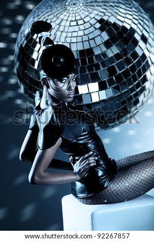 Attractive african woman with disco ball