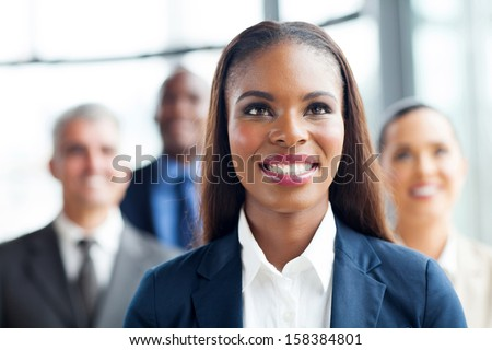 attractive afro american businesswoman and team looking up