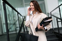 Attractive and beautiful businesswoman talking on cellphone
