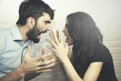attractive angry couple fighting and shouting at each other