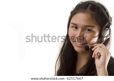 Attractive Asian business woman wearing headset and smiling