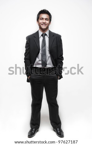 Attractive asian businessman doing different poses