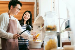 Attractive Asian couple marry family  preparing cooking food dinner together with happiness and freshful in home kitchen family ideas concept