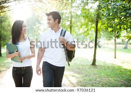Attractive asian couple spending time together in the park
