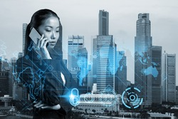 Attractive Asian cybersecurity developer having conference call to protect clients confidential information by inventing solutions. IT lock icons over Singapore city background.