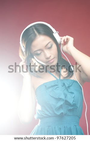 Attractive asian enjoying time with entertainment