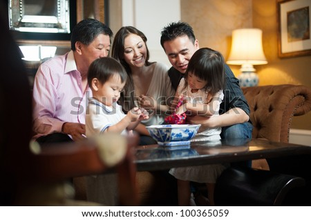 attractive asian family in...