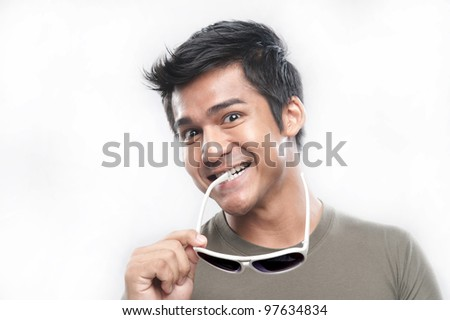 Attractive Asian Man With Sunglasses and Expression