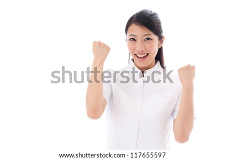 attractive asian nurse showing her muscle on white background