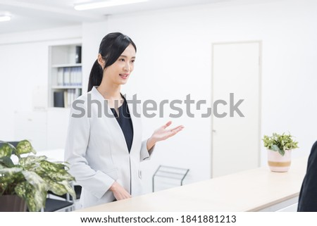 Attractive asian receptionist in office.