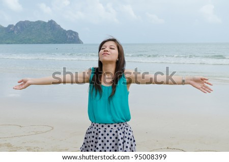 Attractive Asian woman close her eyes on the beach