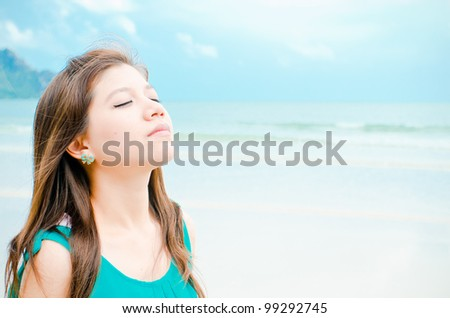 Attractive Asian woman enjoy on the beach