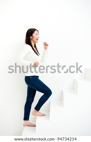 attractive asian woman going up on the stairs