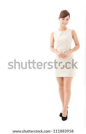 attractive asian woman standing on white background - stock photo