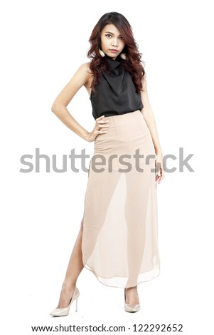 attractive asian woman standing on white background