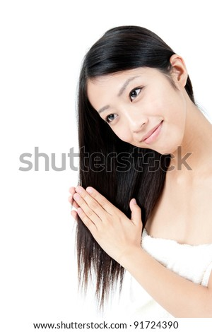 attractive asian woman taking care of her hair