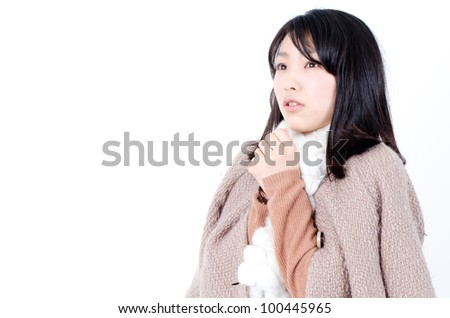 attractive asian woman wearing a coat