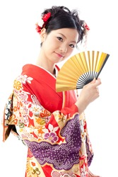 attractive asian woman wearing japanese kimono holding traditional fan on white background