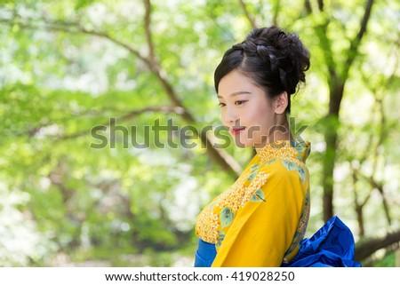 "attractive Asian woman wearing traditional Japanese casual summer kimono called ""Yukata"". #419028250"