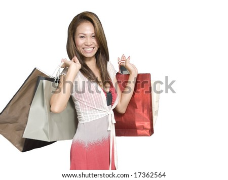 Attractive Asian woman with shopping bags